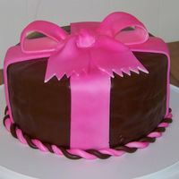 Pink Bow Cake WASC cake covered in BC & chocolate MMF. My first bow. The bow cracked a little, but I am real proud of this cake. I did use an flower...