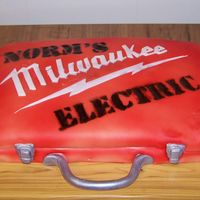 Norm's Electric Drill Box Made this cake for the shop by BF works at. They loved it! Made to look like a drill box cake w/the companies name stenciled on top....
