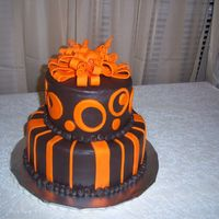 Ashtyn's Cake   Chocolate buttercream tinted dark brown with orange fondant circles and stripes.