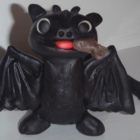 How To Train Your Dragon: Toothless  I made this cake for a friend's daughter's birthday. Toothless is fondant with an inner structure of foil and toothpicks. I had...