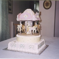 Carousel Cake The horses are all made of cookies with royal icing flowers, hair, & harnesses. Top 'crown' is made of chocolate with royal...