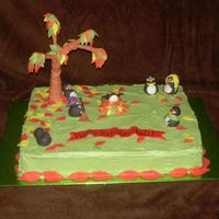 Penguin Cake   Heidi has a great love for penguins. Because Heidis birthday is in the fall, the penguins are raking the leave for a fall setting.