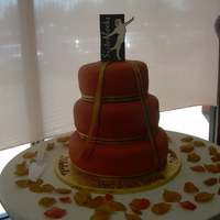 Sister Locks Book Siging   This is a vanilla cake with buttercream icing and a burnt orange fondant overlay.