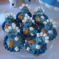 """its A Boy"" Baby Shower Cupcakes cut adorable baby shower cupcakes. they are blue since it is for a boy. teddy graham bears, marshmallow bottles, blue melted chocolate pins..."