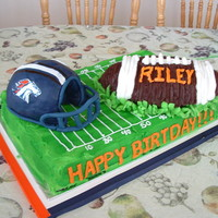 Football Birthday For my sons friend... he is a big bronco's fan. The helmet is ricecrispy and covered in fondant/gumpaste. All the rest is butter cream...