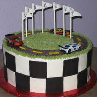 "Race Car Birthday 10"" cake with buttercream and fondant accents. The cars are real. Wanted to make my own, but customer called me the day before the..."