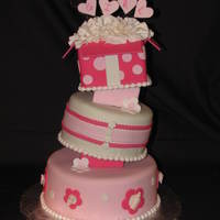 It's A Girl 8-6-4 cakes covered in Satin Ice fondant. First attempt at tospy turvy using styrofoam blocks.
