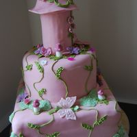 Enchanted Fairytale Castle Tower Cake   this was for a 6th bithday girl who was into all things girly so i came up with this.