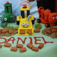 Bob The Builder  a 2nd birthday cake with scoop, rolly and dizzy. one of the pics shows the birthday boy trying to move them, the other is the distruction...
