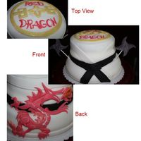 Red Dragon Cake Fondant covered cake for a martial arts studio. 2 Tiers, 3 layers each.