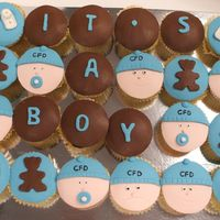 Welcome Gift For Baby Boy  Vanilla bean cup cakes with white chocolate and some choclate ganche covered and decorated with fondant. Baby faces idea from Planet Cake!...