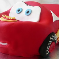 Lightning Mcqueen First attemptat carving a 3D cake. Chocolate mud covered in chocolate ganache with fondant and fondant accents. The only non-edible part...