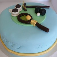80Th Cake For An Active Woman! A banana cake covered with white chocolate ganache (albeit a little runny) covered with fondant. I made GP tennis racquet & ball, lawn...