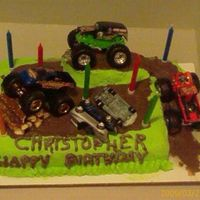 Monster Trucks Birthday Cake 9x13 chocolate cake with the ramp cut out from the side and placed on top. Butter cream for the green and chocolate butter cream for the &...