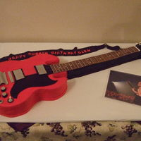 Gibson Sg Guitar Cake  This is my first sculpted/3-D cake, and of course my first guitar cake. Many thanks to Lucy18 for her help and advice. I'm pretty...