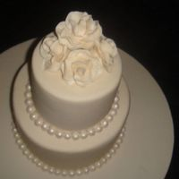 Ivory Wedding Cake With Roses And Pearls THIS IS THE FIRST WEDDING CAKE I MADE. PEARLS AND ROSES ARE HANDMADE.