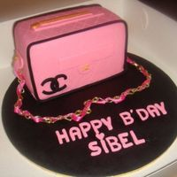 Chanel Bag Cake this was for my friends bday. everything is edible except the chain and the ribbon. its a chocolate mud cake filled with dark chocolate...