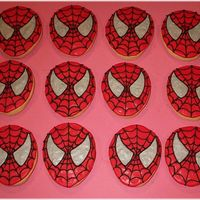 Spiderman Cookies Decorated in RI, silver luster dust for the eyes. These went with the spiderman cake. Kids loved them!