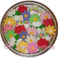 Spring Flowers Decorated in all RI. Flower cookie platter for a 90th birthday celebrations.