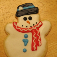 Snowman Cookie Sugar cookies for Christmas, decoarated with royal icing.