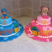 "Umizoomi Cakes For Twins   Each cake is 8""x3"", and 4""x2"". covered in fondant with fondant details. characters are RKT and fondant. TFL :)"