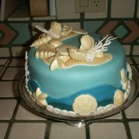 Undersea Beach Theme Cake Final project in cake decorating class. Blue fondant covered with white chocolate seashells