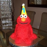 Elmo......1St Birthday This was my first attempt at a 3D cake.....overall....pretty simple.....just very time consuming doing all the fur!! Only thing I would...