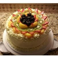 Refreshing Cake French Vanilla with Strawberries & Cream. BC Frosting. Fresh Fruit on top covered with a clear fruit glaxe.