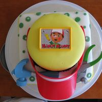 Handy Manny Birthday Cake  This was a fun cake to make for a 3 year old boy's birthday party...and very last minute! Yellow WASC cake with white chocolate...