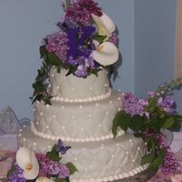 Garden Wedding Cake Fondant with cream cheese icing and edible butterflies. Hand painted cake fondant covered cake board. Fresh flowers also arranged for bride...