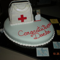 Lvn Graduation Fondant nurses bag on top of fondant covered base. Fondant stethoscope on side of cake. I wasn't too sure about this one, but everyone...