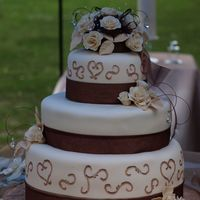 123793408241443.jpg this wedding cake was the cake from Hades!!! Nothing went the way it was supposed to with this one... I had to cover the 6 in. twice. Then...