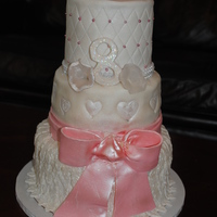 Anniversary Pink And White 3 tier fondant with gumpaste bow and flowers done 0ut of the lucks edible print on the flowers