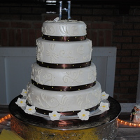 4 Teir Round Wedding Cake With Fondant This cake is 4 teir buttercream iceing and fondant covering I had to use real brown ribbon due to the humidity which ruined the first go...