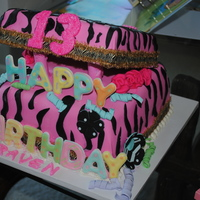 Birthday Box Cake With Pink Fondant mom ordered cake for her daughter turning 13 so was very much into the zebra printcake in the bottom and the lid covered by pink fondant,...