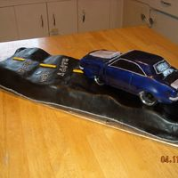 Camaro, 36Th Bday Cake This a camaro and road cake that I made for my husbands 36th Bday. When placing the car onto the road.. It made a wrong turn.....the front...