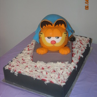 Garfield Grooms Cake This cake was made for a friends wedding. He is sitting in a pan of lasagna, doesnt quite look like lasagna, but was too late to change it...