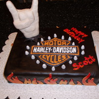 Harley-Davidson Riding, Heavy Metal Rocker Cake. Yellow cake, strawberry filling, chocolate fondant, hand is RCT. Logo is frozen buttercream transfer.