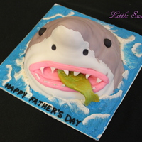 Shark Cake Sculpted from a large dollpan, next time I make this I would shave the back of the head a little more so it has more sleekness of a shark...