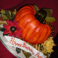 Fall Pumpkin  Half spice, half devil's food bundt cakes with cream cheese icing covered in mmf. Stem, tendrils, and banner in gumpaste. Silk flowers...