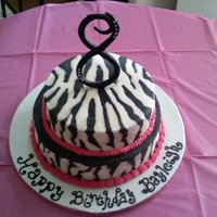 "Bayleigh   2 tier white cake with zebra and hot pink. Gum paste blingy ""8"""