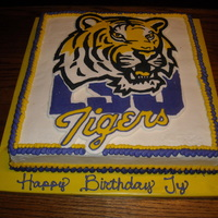 Lsu White cake with frozen buttercream transfer.