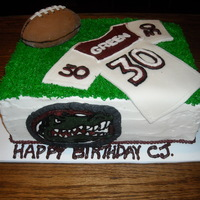 Cj   BC with fondant accents. Gator logo of a local high school mascot.
