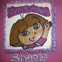 Shaela FBCT Dora the Explorer on cream cheese icingand strawberry cake.