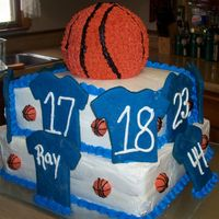 Basketball Cake This cake was made for my daughter's end of season party. The blue shirts are cookies that I tinted blue before baking. There were a...