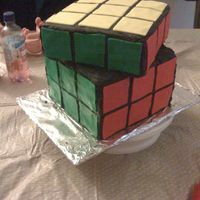 Rubics Cube   My son is a cuber and this is the cake he requested for his birthday. It is a white cake with bc. the squares are fondant.