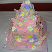 Welcome Baby buttercream icing, royal icing flowers, color flow butterflies