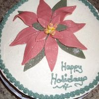Poinsettia Christmas Cake 2Nd  My husband had a Christmas Party and said he needed to bring something so I made yet another poinsettia Christmas cake same as my first one...