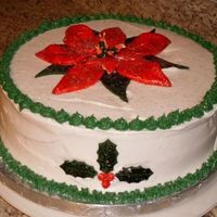 Poinsettia Christmas Cake  This was my very first cake I made using gum paste flowers. Never took a class just went to the store bought it sat down and made it. The...
