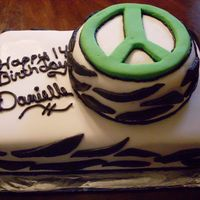 Zebra Stripes And Peace Sign  This was my first order from a stranger so I was soooo stressed. This cake was a chocolate cake, buttercream frosting and MMF. It was for a...